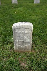 26 August 2017:   A part of the History of McLean County Illinois.<br /> <br /> Tombstones in Evergreen Memorial Cemetery.  Civic leaders, soldiers, and other prominent people are featured.<br /> <br /> Section 5, the old town soldiers area<br /> Oscar St. ?