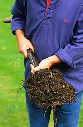 Garden compost on a spade