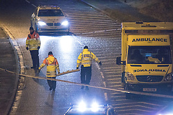 © Licensed to London News Pictures. 03/01/2017. Huddersfield, UK. Police erect a screen around the scene of a bullet riddled white Audi car at the slip road at Junction 24 of the M62 motorway in Huddersfield . West Yorkshire police have announced a man has died following the discharge of a police firearm , during what they describe as a pre-planned operation , yesterday evening (2nd January 2017) . Photo credit : Joel Goodman/LNP