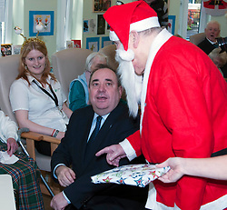 First Minister Alex Salmond, accompanied by Santa Clause (Arthur Martin), visited the Dean Club in Stiockbridge Edinburgh today to distribute Christmas presents to the residents.  (c) GER HARLEY   StockPix.eu