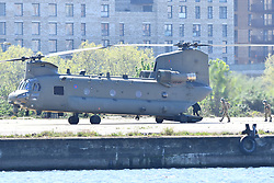 © Licensed to London News Pictures. 20/04/2020. London UK: People board an RAF Chinook helicopter after in landed at the Nightingale hospital in East London. Photo credit: Steve Poston/LNP