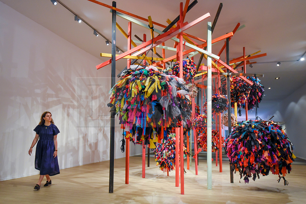 © Licensed to London News Pictures. 25/06/2019. LONDON, UK. A staff member views Phyllida Barlow's installation for Masterpiece Presents with Hauser & Wirth at a preview of Masterpiece London 2019, the world's leading cross-collecting art fair held in the grounds of the Royal Hospital Chelsea.  The fair brings together 157 international exhibitors presenting works from antiquity to the present day and runs 27 June to 3 July 2019.  Photo credit: Stephen Chung/LNP