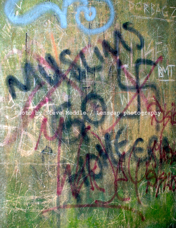 Racist Graffiti Sprayed on a Wall