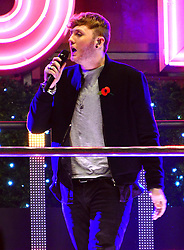 James Arthur performs as Christmas lights for the famous London High Street are turned on at event hosted by Selfridges on Oxford Street, London, United Kingdom. Tuesday, 12th November 2013. Picture by Nils Jorgensen / i-Images