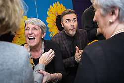 "© Licensed to London News Pictures . 12/01/2016 . Salford , UK . GARY BARLOW (pictured with the original Women's Institute members who made the calendar ) backstage after making a surprise appearance at the Lowry Theatre ,  during the opening week of "" The Girls "" , a musical he wrote based on the story "" Calendar Girls "" , about a group of Women's Institute members in Yorkshire , who made a nude calendar . Photo credit : Joel Goodman/LNP"