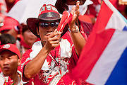 """Mar. 27, 2010 - BANGKOK, THAILAND: People applaud during a speech by Red Shirt leader Veera Musigapong in Bangkok Saturday. More than 80,000 members of the United Front of Democracy Against Dictatorship (UDD), also known as the """"Red Shirts"""" and their supporters marched through central Bangkok March 27 during a series of protests against and demand the resignation of current Thai Prime Minister Abhisit Vejjajiva and his government. The protest is a continuation of protests the Red Shirts have been holding across Thailand. They support former Prime Minister Thaksin Shinawatra, who was deposed in a coup in 2006 and went into exile rather than go to prison after being convicted on corruption charges. Thaksin is still enormously popular in rural Thailand.    PHOTO BY JACK KURTZ"""