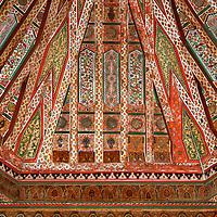 North Africa, Morocco, Marrakesh. Zellij woodwork ceiling of El Bahia Palace