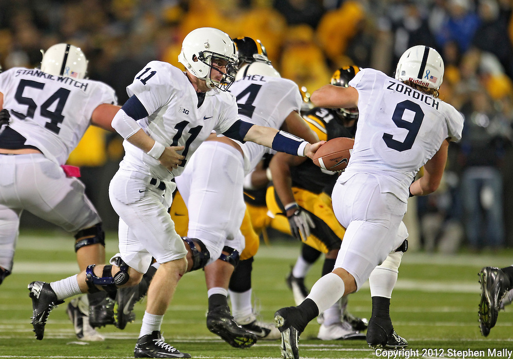 October 20 2012: Penn State Nittany Lions quarterback Matthew McGloin (11) hands the ball off to Penn State Nittany Lions fullback Michael Zordich (9) during the second half of the NCAA football game between the Penn State Nittany Lions and the Iowa Hawkeyes at Kinnick Stadium in Iowa City, Iowa on Saturday October 20, 2012. Penn State defeated Iowa 38-14.