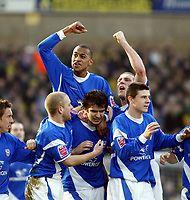 Photo: Chris Ratcliffe.<br />Norwich City v Ipswich Town. Coca Cola Championship. 05/02/2006.<br />Jimmy Juan (C) of Ipswich is mobbed by Danny Haynes (L above) and Jason De Vos (arm raised right) after scoring from a free kick.