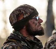 Dave Prather from Bartlesville watches for incoming ducks while hunting near Shamrock, Oklahoma