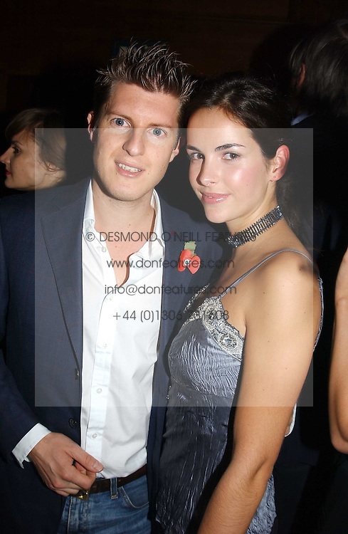 MR JEREMY SINGER and MISS OCTAVIA KHASHOGGI  at a party hosted by Tatler magazine to celebrate the publication of the 2004 Little Black Book held at Tramp, 38 Jermyn Street, London SW1 on 10th November 2004.<br /><br />NON EXCLUSIVE - WORLD RIGHTS