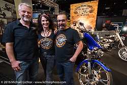 Andreas Scholz, Simone Messer and Axel Scherer of Custom Chrome Europe man their booth in the custom focused Hall 10 at the Intermot Motorcycle Trade Fair. Cologne, Germany. Wednesday October 5, 2016. Photography ©2016 Michael Lichter.