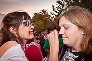 """Oct. 30, 2009 -- PHOENIX, AZ: BAILEY CURRY, left, helps ELLIE EVANS put on makeup before the Zombie Walk in Phoenix. About 200 people participated in the first """"Zombie Walk"""" in Phoenix, AZ, Friday night. The Zombies walked through downtown Phoenix """"attacking"""" willing victims and mixing with folks going to the theatre and downtown sports venues.  Photo by Jack Kurtz"""