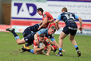 Gareth Davies of the Scarlets © is tackled by Gareth Anscombe of the Cardiff Blues. Guinness Pro12 rugby match, Scarlets  v Cardiff Blues at the Parc y Scarlets in Llanelli, West Wales on Saturday 2nd April 2016.<br /> pic by  Andrew Orchard, Andrew Orchard sports photography.