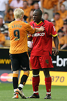 Photo: Paul Greenwood. <br />Wolverhampton Wanderers v Watford. Coca Cola Championship. 11/08/2007. <br />Wolves Andy Keogh and Watford's Danny Shittu square upto each other