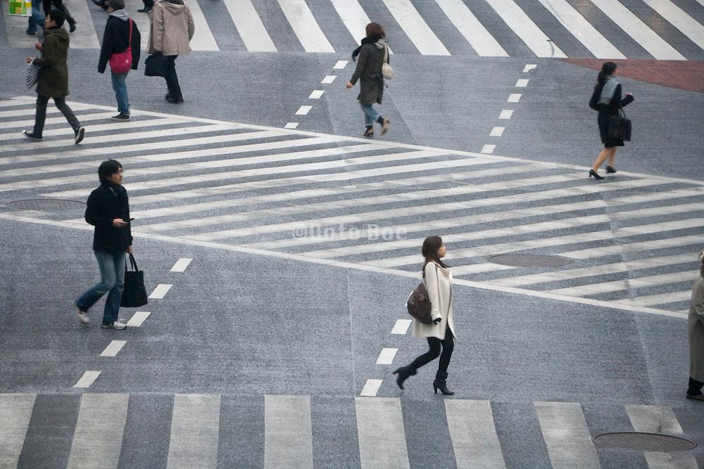 last people for light gets red Hachiko pedestrian crossing in Shibuya Tokyo