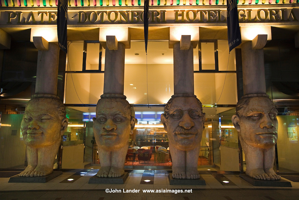 Faces at Dotonbori Hotel in Osaka with an amazing entrance featuring four huge columns with faces depicting the special qualities in human beings. The face columns act as a landmark and define the hotel's traditional architecture.