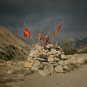 """Shrine named """"Kuda Kon"""", on the edge of  a village. Cloth are tied up to it, for good luck - Maybe they want to get pregnant, be succesfful at exam, a good harvest etc. The traditional life of the Wakhi people, in the Wakhan corridor, amongst the Pamir mountains."""