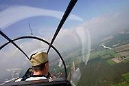 View from the cabin of a sailplane.<br /> <br /> Uitzicht vanuit de cabine van een zweefvliegtuig.