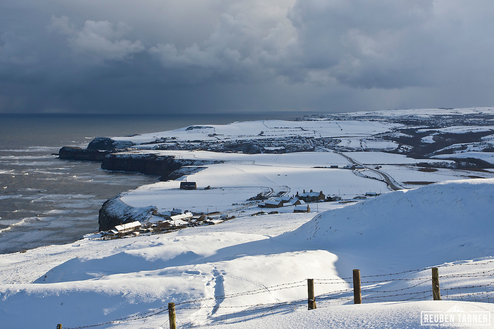 Snow covered fields and cliff tops above Staithes in North Yorkshire. North Yorkshire was covered by an extended and early fall of snow in November 2010.
