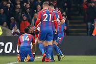 GOAL 1-0 Crystal Palace kneels and celebrates after his goal and is surrounded by his teammates during the The FA Cup 3rd round match between Crystal Palace and Grimsby Town FC at Selhurst Park, London, England on 5 January 2019.