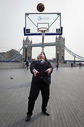 © Licensed to London News Pictures. 08/04/2013. London, UK. Boris Johnson, the Mayor of London, lines up to score a basket by throwing the ball over his shoulder in London today (08/04/2013) as he plays basketball during press call promoting the 2013 Turkish Airlines Euroleague Basketbal tour taking place at the O2. Photo credit: Matt Cetti-Roberts/LNP