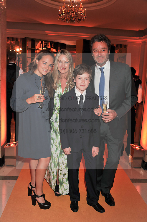 ANYA HINDMARCH her husband JAMES SEYMOUR and their children OCTAVIA SEYMOUR and FELIX SEYMOUR at the annual Veuve Clicquot Business Woman of the Year Award this year celebrating it's 40th year, held at Claridge's, Brook Street, London on 18th April 2012.