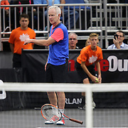 Tennis champion John McEnroe throws his racquet while playing Jim Courier during the PowerShares Tennis Series event at the Amway Center on January 5, 2017 in Orlando, Florida. (Alex Menendez via AP)