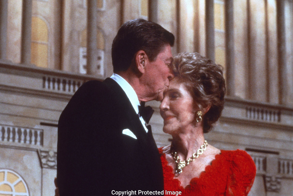 A 27 MG FILE FROM FILM OF:..President Regan kisses Nancy during a salute to Nancy Reagan at the Washington Convention Center. Photo by Dennis Brack