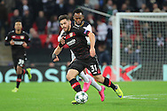 Bayer Leverkusen forward Kevin Volland (31) battles for ball with Tottenham Hostpur midfielder Georges-Kevin Nkoudou (14) during the Champions League match between Tottenham Hotspur and Bayer Leverkusen at Wembley Stadium, London, England on 2 November 2016. Photo by Matthew Redman.