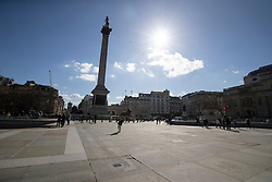 © Licensed to London News Pictures. 16/03/2020. London, UK. Trafalgar Square appears quiet this afternoon . New cases of the COVID-19 strain of Coronavirus are being reported daily as the government outlines it's plans for controlling the outbreak. Photo credit: George Cracknell Wright/LNP