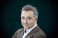 British screenwriter, novelist and occasional actor Frank Cottrell Boyce, pictured at the Edinburgh International Book Festival where he talked about his work. The three-week event is the world's biggest literary festival and is held during the annual Edinburgh Festival. The 2009 event featured talks and presentations by more than 500 authors from around the world.