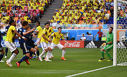 SARANSK, June 19, 2018  Yuya Osako of Japan heads the ball to score during a Group H match between Colombia and Japan at the 2018 FIFA World Cup in Saransk, Russia, June 19, 2018. Japan won 2-1. (Credit Image: © Lui Siu Wai/Xinhua via ZUMA Wire)