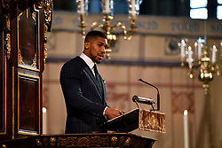 Heavyweight boxer Anthony Joshua speaks during the Commonwealth Service at Westminster Abbey, London on Commonwealth Day. The service is the Duke and Duchess of Sussex's final official engagement before they quit royal life.
