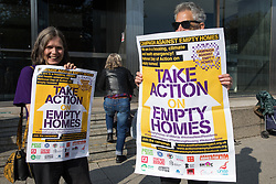 London, UK. 9th October, 2021. Housing campaigners protest outside the empty Millbank Tower as part of a national Empty Homes Day of Action. The protest was organised by groups including Action on Empty Homes, Radical Housing Network and Axe the Housing Act following the approval by Westminster Council and the Mayor of London of plans to redevelop Millbank Tower with no affordable homes as 207 luxury flats, a 150-bedroom 5-star hotel and a cultural centre.