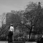 With space at a premium in the vast metropolis of Manhattan, New York City, locals find ways and means for pastime exercise and recreational activities as they and go about their daily lives..Boule in Washington Square Park on May 4, 2004. Photo Tim Clayton