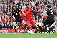 Daniel Sturridge of Liverpool looks to get his shot away under pressure from Andrew Robertson of Hull City. Premier League match, Liverpool v Hull City at the Anfield stadium in Liverpool, Merseyside on Saturday 24th September 2016.<br /> pic by Chris Stading, Andrew Orchard sports photography.
