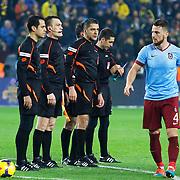 Referee's Bulent Yildirim (C) during their Turkish superleague soccer derby Fenerbahce between Trabzonspor at the Sukru Saracaoglu stadium in Istanbul Turkey on Saturday 07 February 2015. Photo by Aykut AKICI/TURKPIX