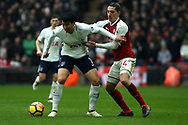 Hector Bellerin of Arsenal (R) in action with Son Heung-min of Tottenham Hotspur (L). Premier league match, Tottenham Hotspur v Arsenal at Wembley Stadium in London on Saturday 10th February 2018.<br /> pic by Steffan Bowen, Andrew Orchard sports photography.
