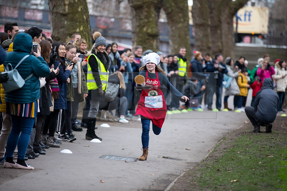 © Licensed to London News Pictures. 13/02/2018. London, UK. Rachael Venables races in the Rehab Parliamentary Pancake Race 2018 in Victoria Tower Gardens. The Parliament Team - made up of MPs, Lords and Ladies - race in a relay against the Media Team - made up of reporters and presenters - whilst continuously flipping pancakes to celebrate Shrove Tuesday, also known as Pancake Day. Photo credit : Tom Nicholson/LNP