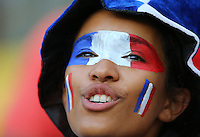 A female fan of France with a painted face