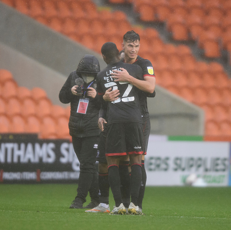Lincoln City's Lewis Montsma celebrates the dramatic victory with Timothy Eyoma<br /> <br /> Photographer Chris Vaughan/CameraSport<br /> <br /> The EFL Sky Bet League One - Blackpool v Lincoln City - Saturday 3rd October 2020 - Bloomfield Road - Blackpool<br /> <br /> World Copyright © 2020 CameraSport. All rights reserved. 43 Linden Ave. Countesthorpe. Leicester. England. LE8 5PG - Tel: +44 (0) 116 277 4147 - admin@camerasport.com - www.camerasport.com