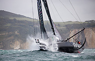 COWES, ENGLAND - 8 AUGUST 2021: The 49th edition of the biennial Rolex Fastnet Race starting from the Royal Yacht Squadron line in Cowes, UK on Sunday 8th August 2021, rounding the 'Fastnet Rock' in Southern Ireland and then finishing in Cherbourg-en-Cotentin. Pictures of British yachtsman Alex Thomson and co skipper Ollie Heer crossing the startling this morning <br /> (Photo by Lloyd Images)