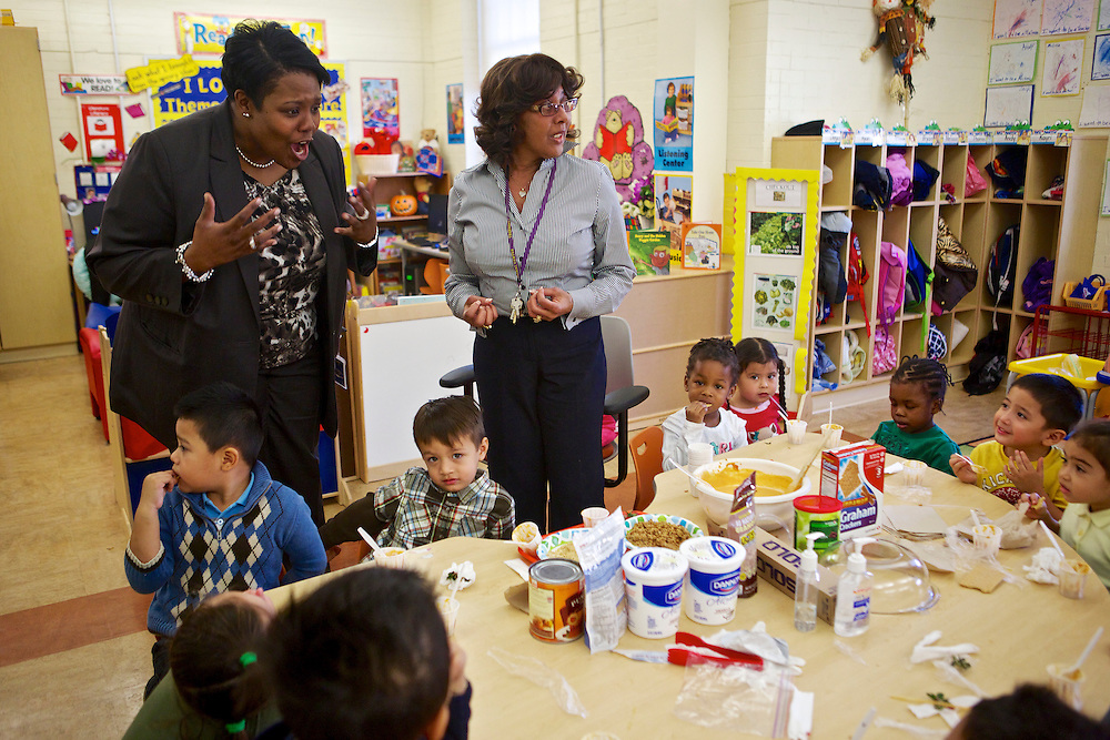 D.C. Public Schools Chancellor Kaya Henderson, left, talks to preschool students in the classroom of Tilwanda Law, center, at Truesdell Education Campus on Friday, Nov. 16, 2012 in Washington, D.C. Henderson recently announced that she plans to close 20 under-enrolled schools across the district. CREDIT: Lexey Swall for The Wall Street Journal