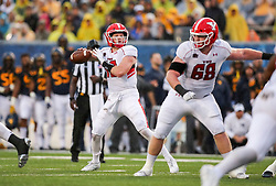 Sep 8, 2018; Morgantown, WV, USA; Youngstown State Penguins quarterback Montgomery VanGorder (12) drops back to pass during the second quarter against the West Virginia Mountaineers at Mountaineer Field at Milan Puskar Stadium. Mandatory Credit: Ben Queen-USA TODAY Sports