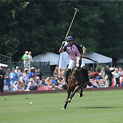 Joaquin Panelo, K.I.G. in action during the White Birch Vs K.I.G Polo match in the Butler Handicap Tournament match at the Greenwich Polo Club. White Birch won the game 11-8. Greenwich Polo Club,  Greenwich, Connecticut, USA. 12th July 2015. Photo Tim Clayton