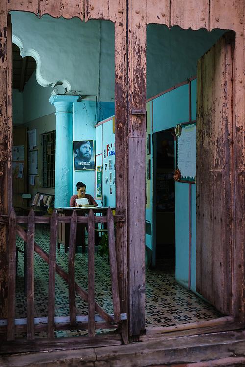 CAMAGUEY, CUBA - CIRCA JANUARY 2020: Cuban woman working inside a home in Camaguey