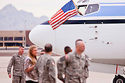 """15 JANUARY 2012 - PHOENIX, AZ:    The plane carrying returning solders flies an American flag on arrival at the The 161st Air Refueling Wing of the Arizona Air National Guard in Phoenix. About 100 soldiers of A (Alpha) Company of the 422nd Expeditionary Signal Battalion (referred to as """"Alpha 4-2-2"""") of the Arizona Army National Guard returned to Arizona on Sunday, Jan. 15, following a nearly year-long deployment to Afghanistan. More than 10,000 Arizona Army and Air National Guard Soldiers and Airmen have been ordered to federal active duty in support of Operations Noble Eagle, Enduring Freedom, Iraqi Freedom, and New Dawn since September 2001. Approximately 200 Arizona National Guard Soldiers and Airmen are still serving on federal active duty overseas.  PHOTO BY JACK KURTZ"""