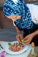 Plating the Salad -- Cooking School and Meal in the Atlas Mountains of Morocco. Image taken with a Nikon 1 V2 camera and 18.5 mm f/1.8 lens (ISO 200, 18.5 mm, f/2.8, 1/500 sec). Semester at Sea Spring 2013 Enrichment Voyage Field Trip.