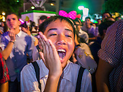 31 DECEMBER 2012 - BANGKOK, THAILAND:  A Thai boy cheers for a band during the New Year's Eve party and countdown in Ratchaprasong Intersection in Bangkok. The traditional Thai New Year is based on the lunar calender and is celebrated in April, but the Gregorian New Year is celebrated throughout the Kingdom, especially in larger cities and tourist centers, like Bangkok, Chiang Mai and Phuket. The Bangkok Countdown 2013 event was called ?Happiness is all Around @ Ratchaprasong.? All of the streets leading to Ratchaprasong Intersection were closed and the malls in the area stayed open throughout the evening.   PHOTO BY JACK KURTZ